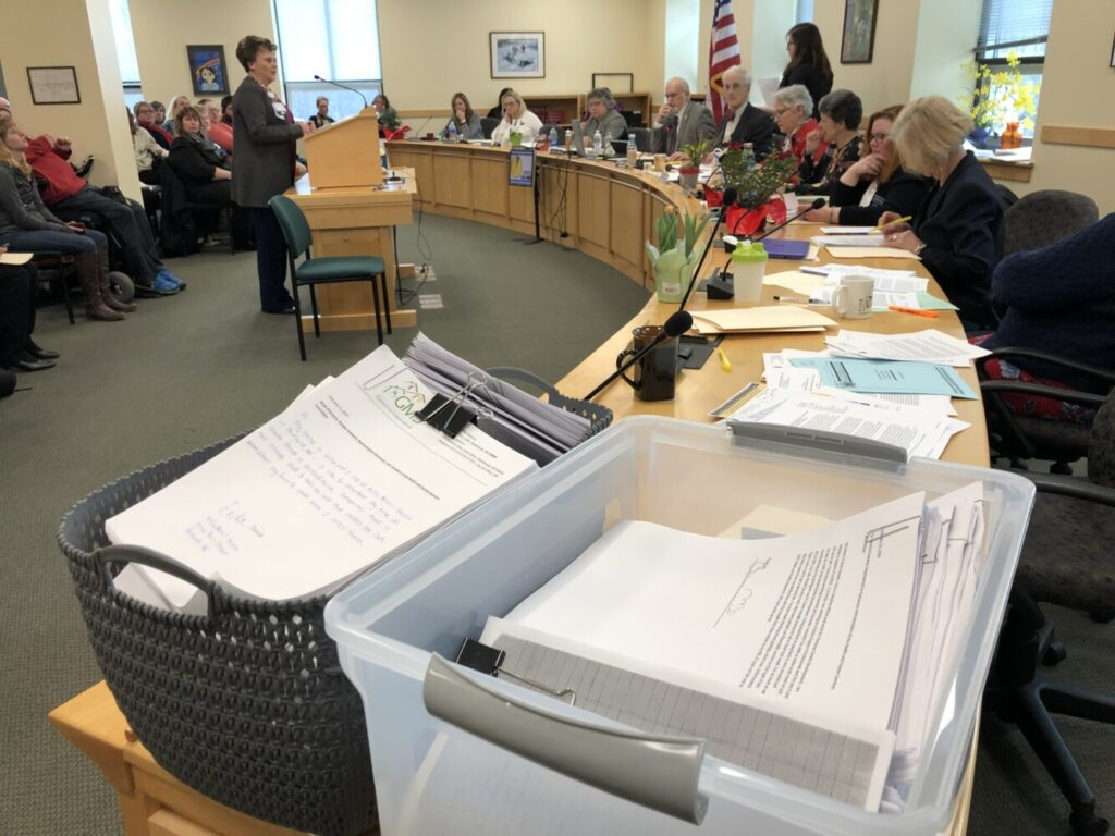 """Two tubs containing written testimony from more than 350 people were delivered Wednesday to the Legislature's Health and Human Services Committee in support of a bill to increase the reimbursement rate for """"direct care"""" workers who provide services to elderly and disabled Mainers."""