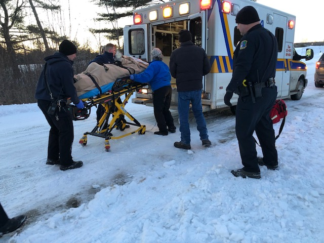 Emergency crews load woman into ambulance Saturday after she was injured in a snow tubing accident at Quarry Road Recreation Area in Waterville.