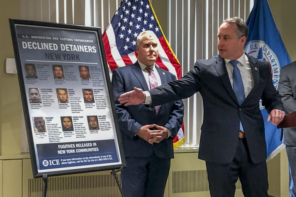"""Matthew Albence, right, the acting director of U.S. Immigration and Customs Enforcement, speaks during a news conference Friday in New York. The country's top immigration official blamed the """"sanctuary policies"""" of New York City on Friday for the sexual assault and killing of a 92-year-old woman, while the mayor's office decried such rhetoric as """"fear, hate and attempts to divide."""""""