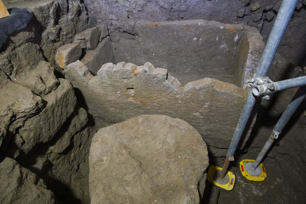 A 1.4-meter (55-inch) wide sarcophagus and what appears to be an altar, dating back to the 6th Century B.C.,  are seen in an underground chamber, at the ancient Roman Forum, during an unveiling to media, in Rome, Friday, Feb. 21.