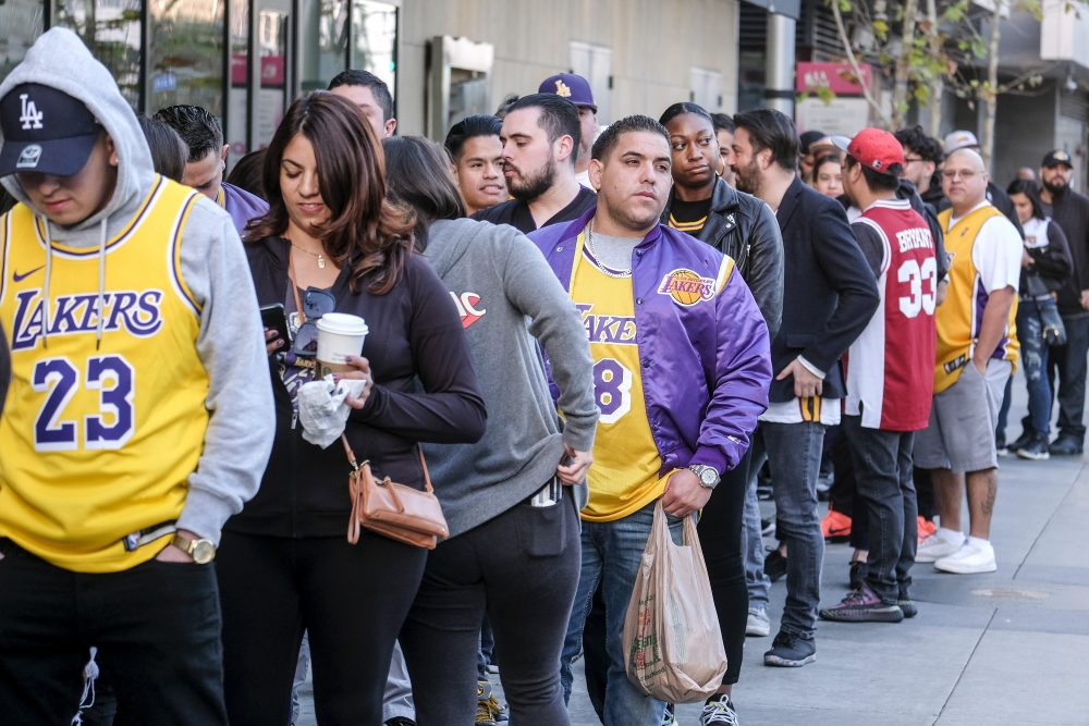 Fans line up to get into the Staples Center to attend a public memorial for former Los Angeles Lakers star Kobe Bryant and his daughter, Gianna, in Los Angeles, Monday, Feb. 24.