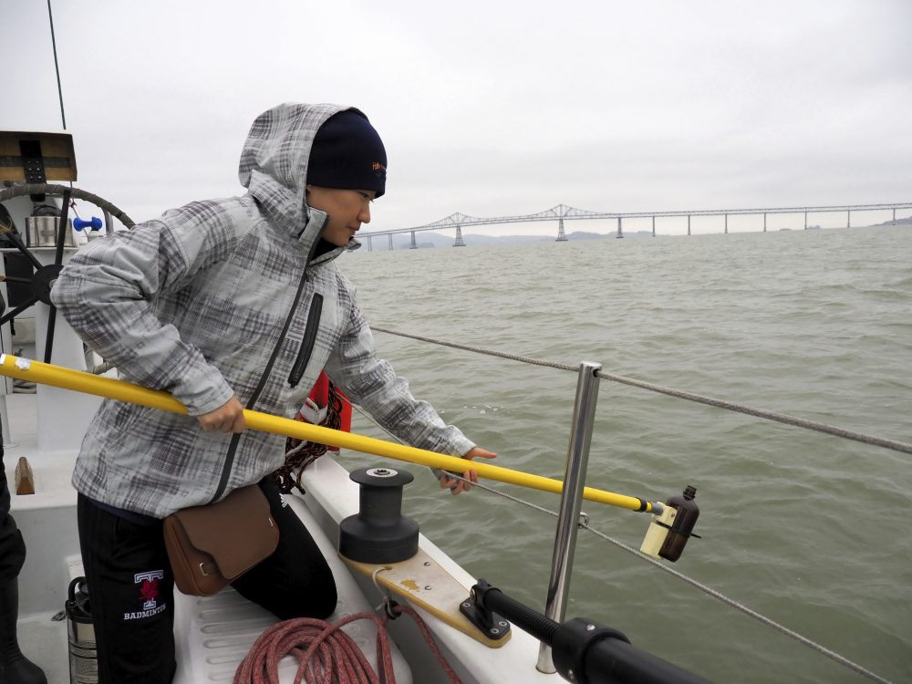 Alice Zhu, with the University of Toronto, prepares to take a sample of water from San Francisco Bay in 2017. The San Francisco Estuary Institute found microplastics in stormwater runoff entering the Pacific Ocean in a three-year study completed in 2019.