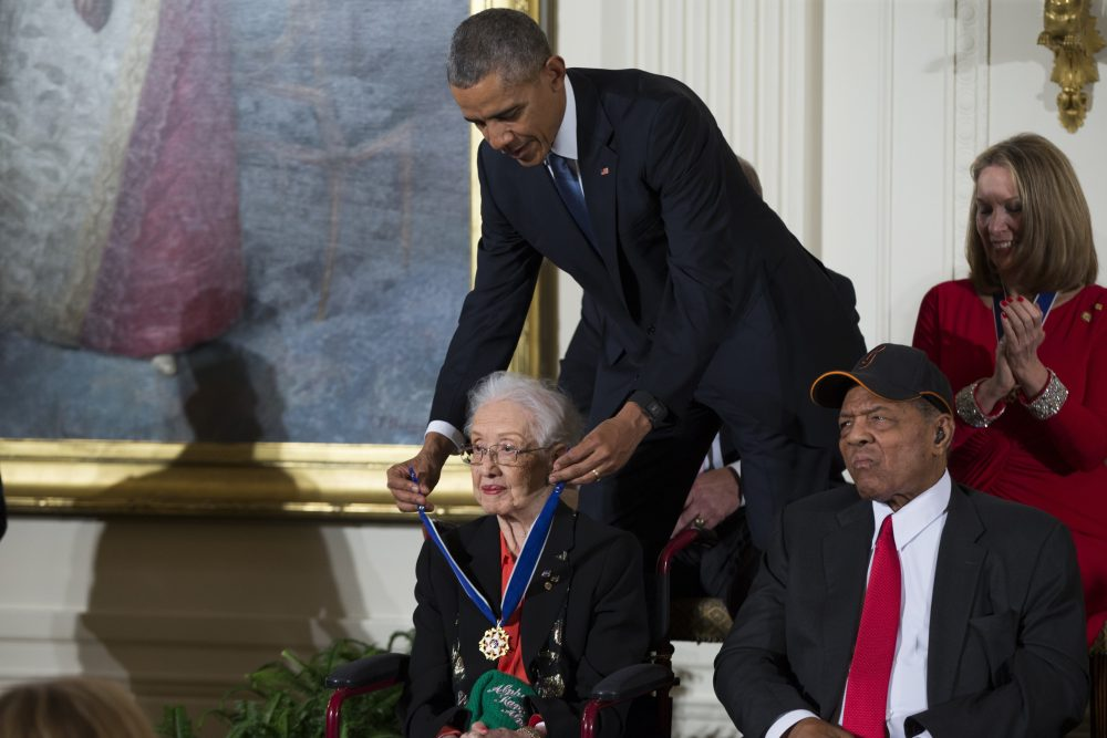 "President Barack Obama presents the Presidential Medal of Freedom to NASA mathematician Katherine Johnson during a ceremony Nov. 24, 2015, in the East Room of the White House, in Washington. Johnson, a mathematician on early space missions who was portrayed in film ""Hidden Figures,"" about pioneering black female aerospace workers, died Monday."