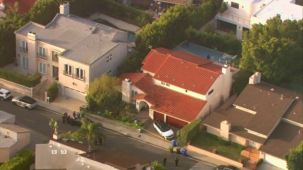 This aerial photo taken from video provided by Fox11 News KTTV-TV shows the Hollywood Hills home, center, where Pop Smoke, 20, was shot and killed early Wednesday, Feb. 19 in Los Angeles.