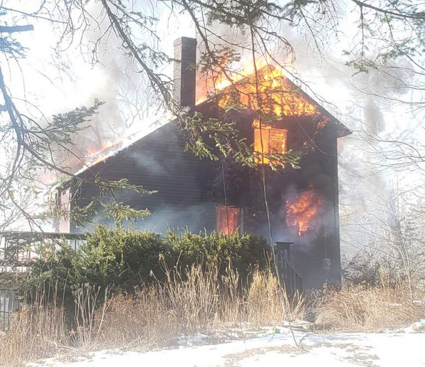 The fire was spotted by people passing by the house at 6 Heron Cove, off Waterman's Beach Road near the intersection with Route 73 in South Thomaston.