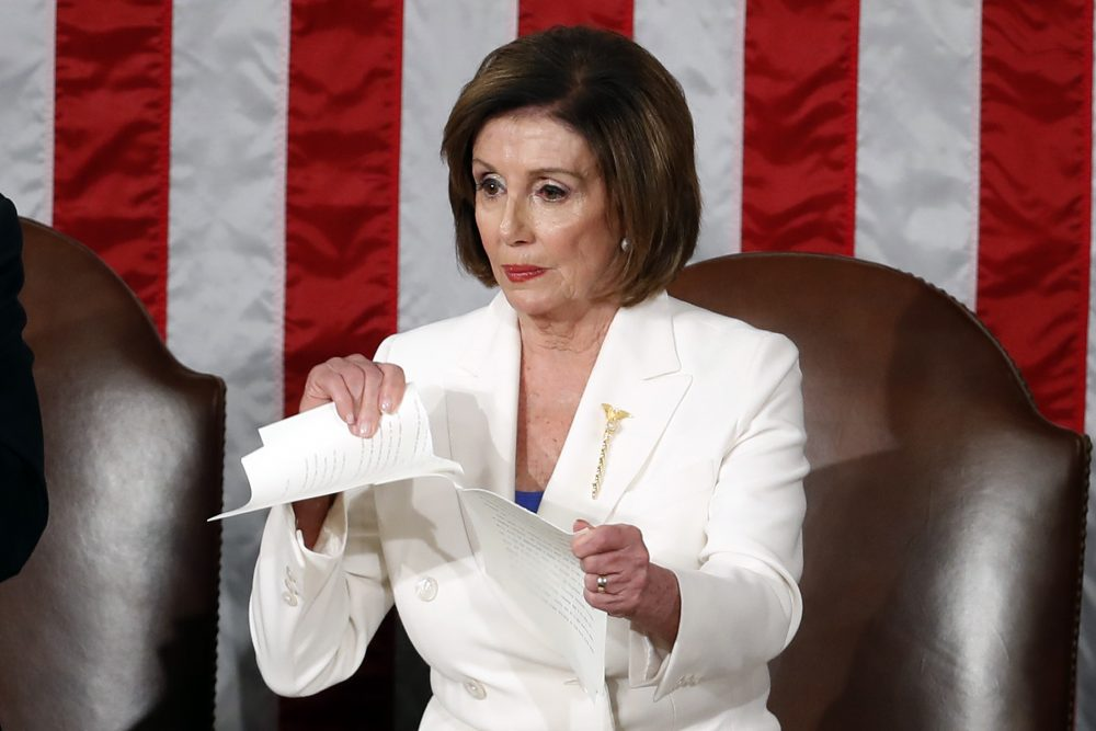 House Speaker Nancy Pelosi tears her copy of President Trump's State of the Union address after he delivered it to a joint session of Congress on Tuesday night.