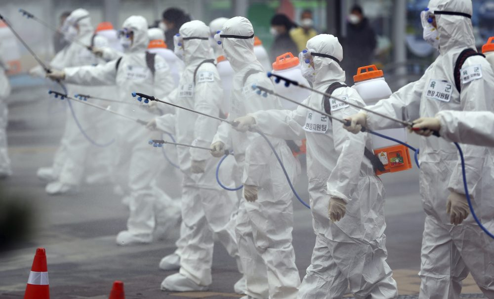 Army soldiers wearing protective suits spray disinfectant Saturday to prevent the spread of the new coronavirus at the Dongdaegu train station in Daegu, South Korea.