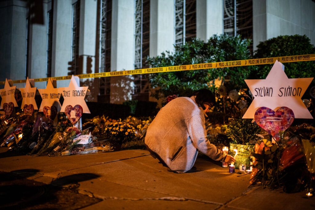 A woman leaves a candle in front of the Tree of Life Synagogue in Pittsburgh after a deadly attack there in 2018. In 2017, anti-Semitic incidents in the United States increased 57 percent, according to the Anti-Defamation League, the largest single-year increase the group has seen and the second-highest total in its history.