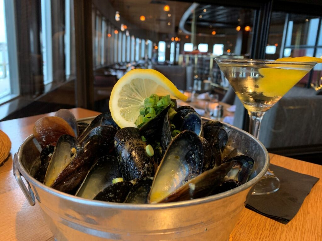 Sauteed mussels and a Lilly Martini are included in the pairing at DiMillos on the Water in Portland.