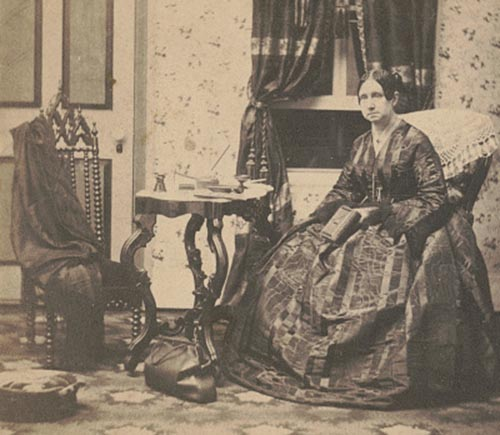 This photo taken from a stereograph shows Dorothea  Dix when she was Superintendent of Army Nurses for the Union Army. There is a medical bag on the floor next to her.