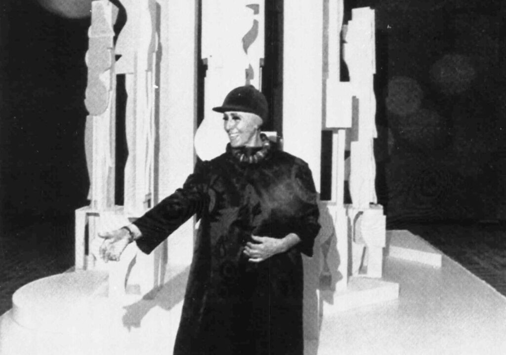 "Sculptor Louise Nevelson poses in front of her sculpture ""Bicentennial Dawn"", in Philadelphia in 1976."