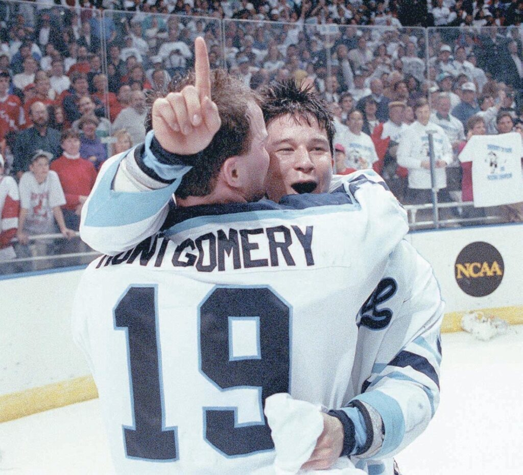 University of Maine players Jim Montgomery and Paul Kariya celebrate their team's national championship win over Michigan in 1993.