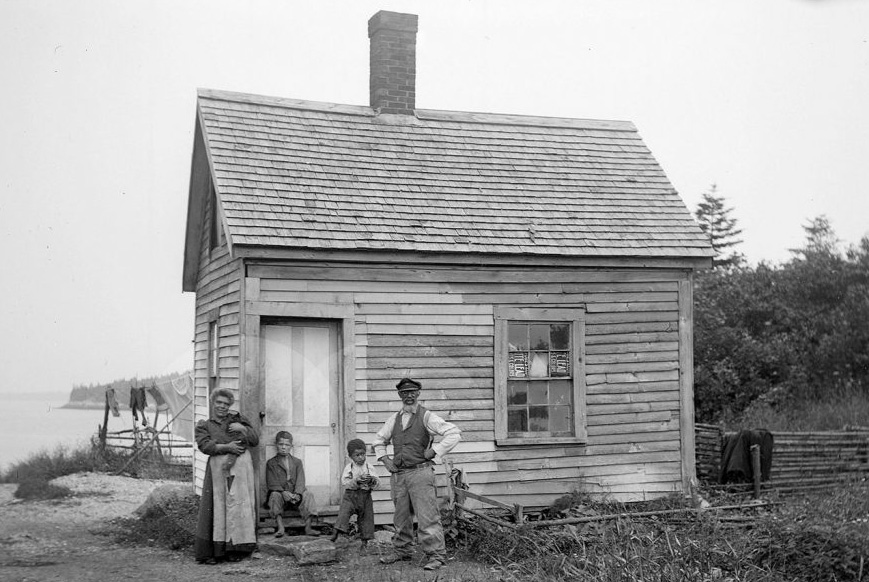 Rosella and John Eason with family in front of their home on Malaga Island in 1911.