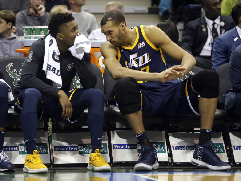 """Utah Jazz center Rudy Gobert, right, was the first player to test postive for COVID-19, and teammate Donovan Mitchell, left, also tested positive. Gobert pledge more than $500,000 toward relief efforts in what he said was the first of """"many steps."""""""