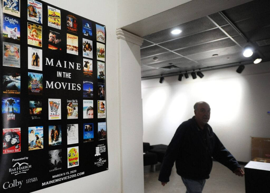 A poster announcing the upcoming Maine in the Movies event is displayed at Railroad Square Cinema in Waterville Maine Monday.