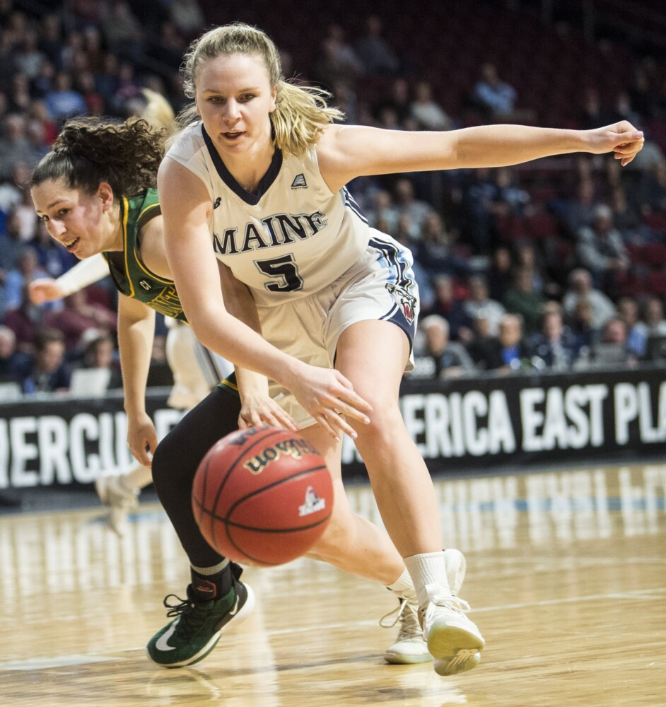 University of Maine's Maeve Carroll (5) battles for the loose ball with  University of Vermont's Josie Larkins (5) during an America East Conference quarterfinal game in March at the Cross Insurance Center in Bangor.