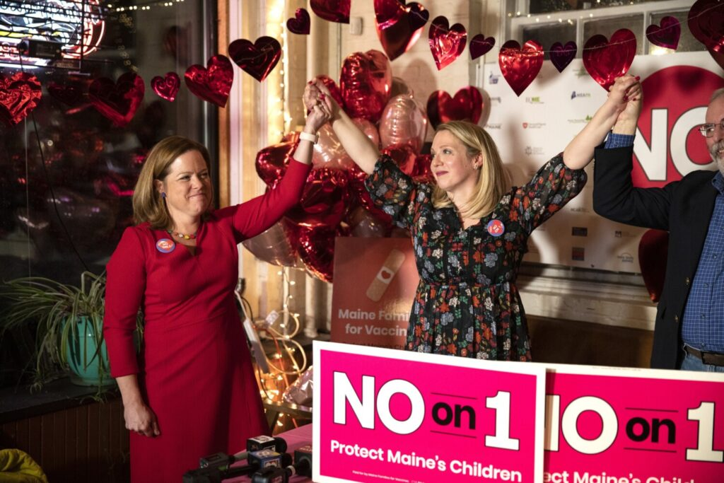 "Caitlin Gilmet, center, and Dr.  Laura Blaisdell, co-chairs of the ""No on 1"" campaign, celebrate after addressing the crowd at their election night watch party at Salvage BBQ on Tuesday in Portland."
