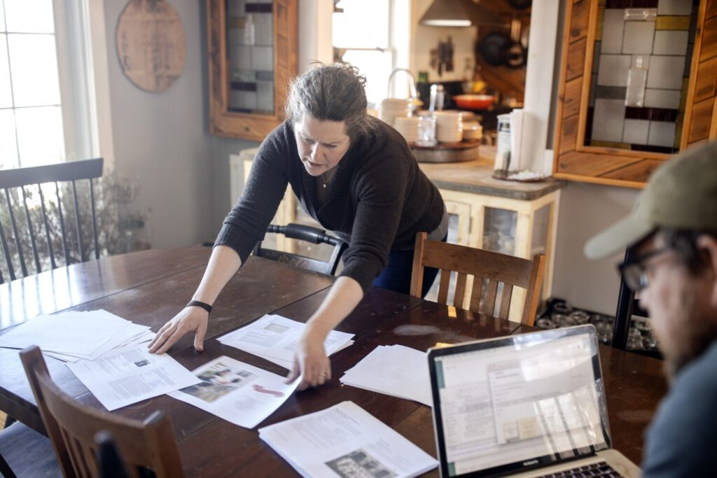 Writers Karl Schatz and Margaret Hathaway look over page drafts for the Maine Bicentennial Cookbook at their home, Ten Apple Farm. The cookbook, scheduled to come out in June, is one of many food and drinks efforts to celebrate the state's 200th birthday.