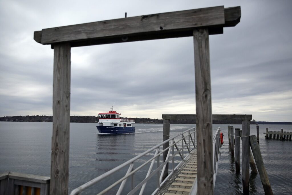 The passenger ferry Independence arrives at the dock on Chebeague Island.