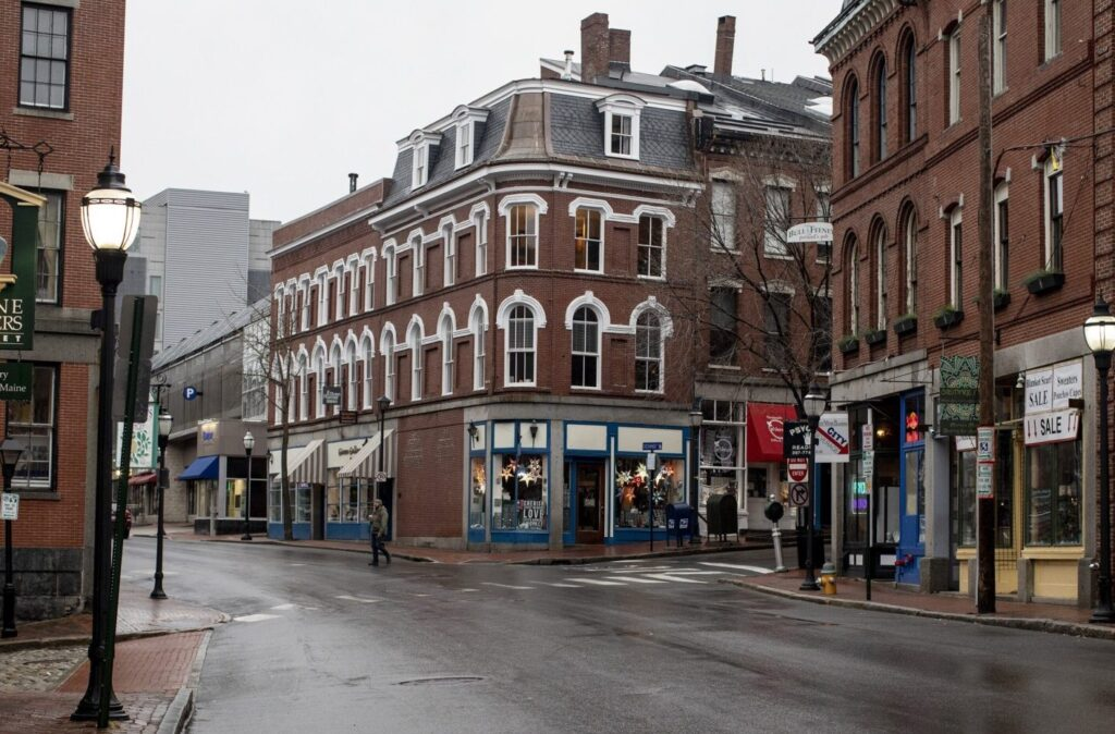 Fore Street, in the heart of Portland's Old Port, was nearly empty on St. Patrick's Day, after the city announced a curfew for businesses. Only take-out or pickup was allowed at restaurants.