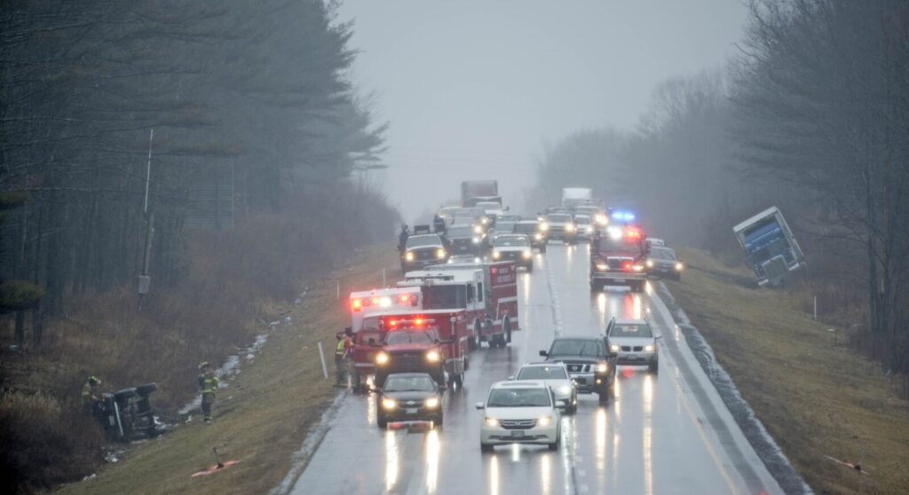 Rescue crews from Waterville, Oakland, Winslow and Delta Ambulance respond to a multi-car accident near exit 127 on Interstate 95 in Waterville on Friday.