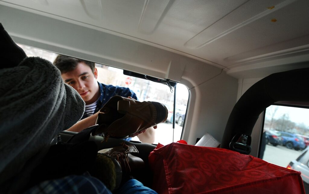 Colby College student Gabriel Dumoulin of Connecticut loads his belongs into his vehicle Sunday outside the Bill & Joan Alfond Main Street Commons, a Colby dorm in downtown Waterville.