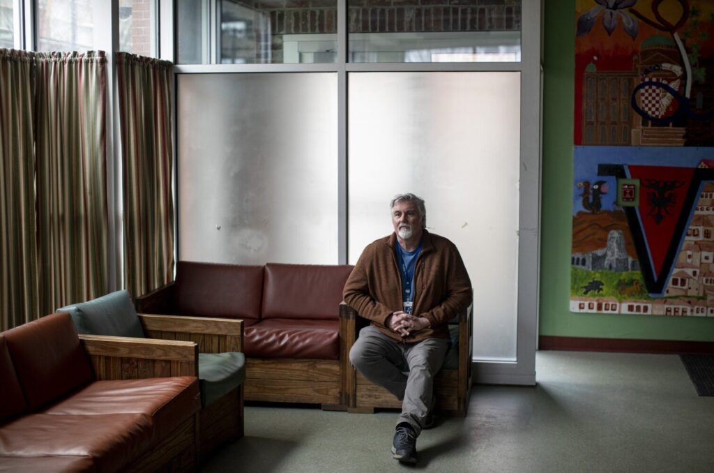 Executive Director of Preble Street Mark Swann sits for a portrait inside the teen shelter on March 17.