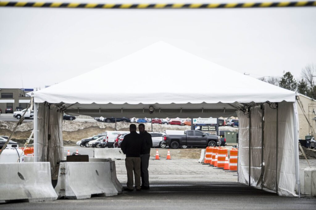 Workers from Inland Hospital prepare a drive-up coronavirus testing site Thursday in the parking lot adjacent to Faith Evangelical Free Church on Kennedy Memorial Drive in Waterville.