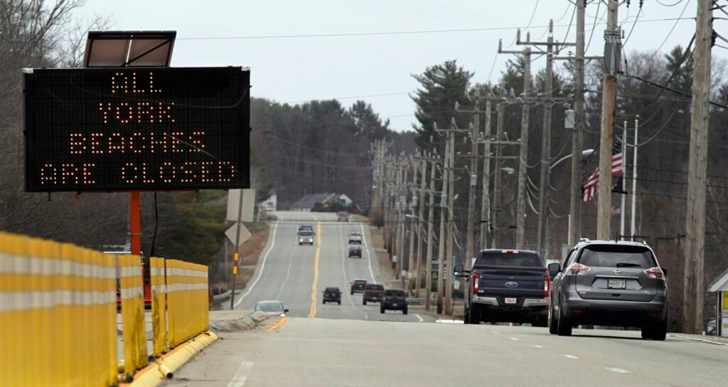 A sign on Route 1 in York alerts people Monday that beaches in the town are closed. York has shut down its public beaches because large numbers of people crowded beaches this past weekend, and other coastal towns in southern Maine are considering doing the same.