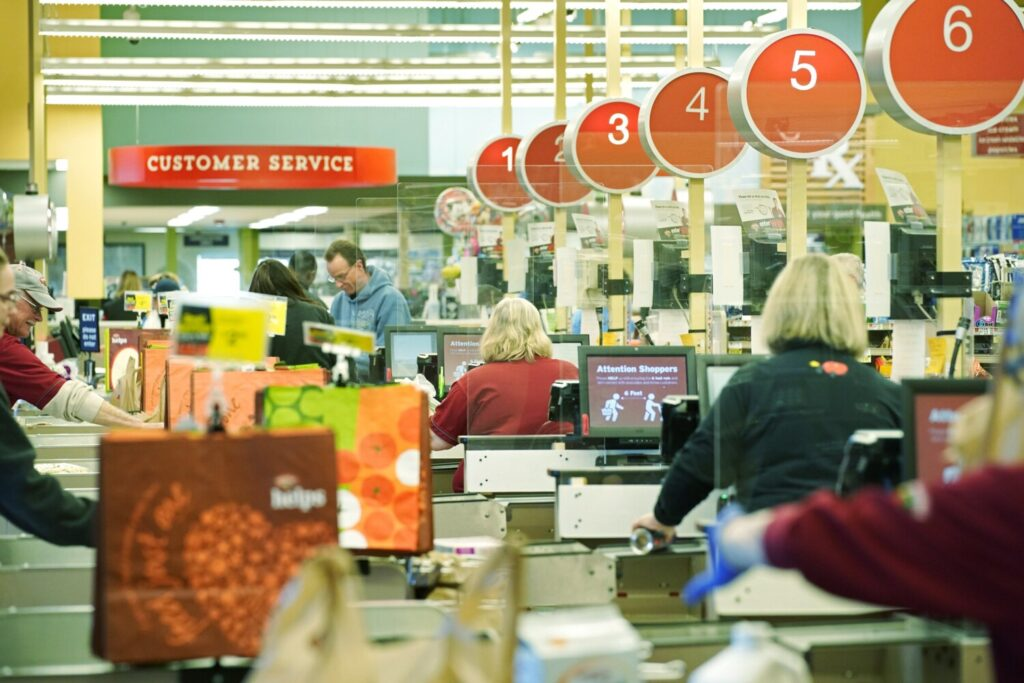 Cashiers ring up customers at the Hannaford supermarket in Scarborough on March 27. Hannaford stores have installed Plexiglas barriers at the cash registers as a safety precaution for cashiers and customers during the coronavirus outbreak.