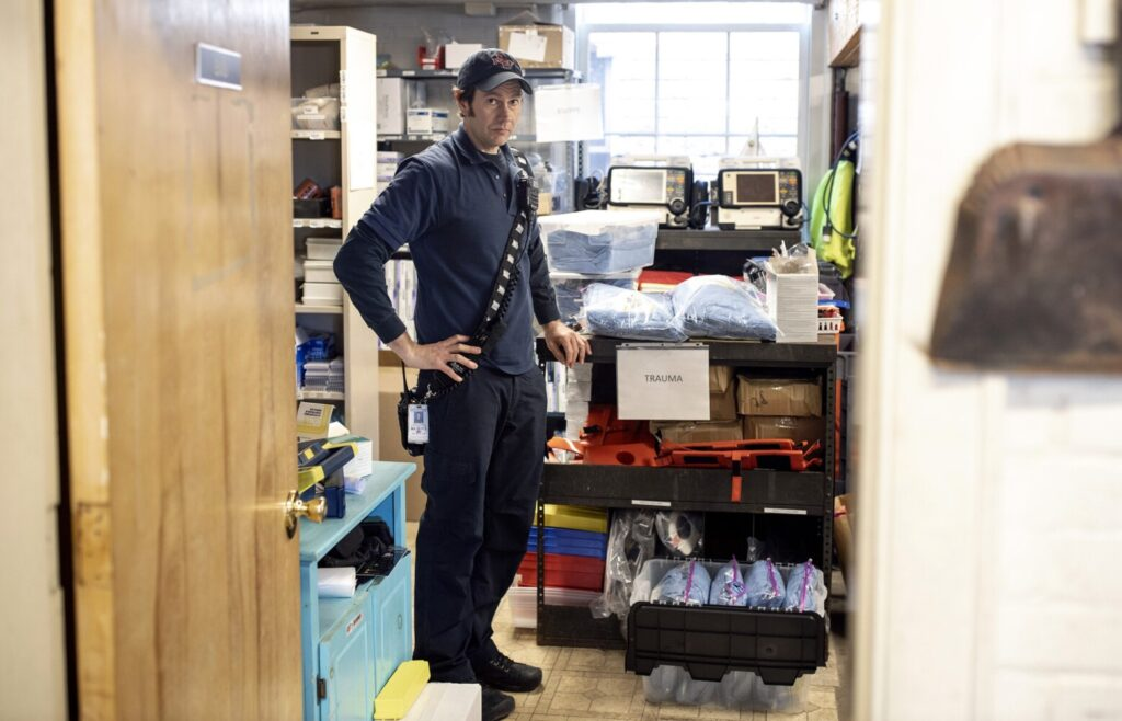 """South Portland Deputy Fire Chief Phil Selberg shows the supply room at the Central Fire Station that houses personal protective equipment. Selberg said EMTs respond to several respiratory calls, potential COVID-19 cases, every day. """"I would liken it to a hazmat call,"""" he said."""