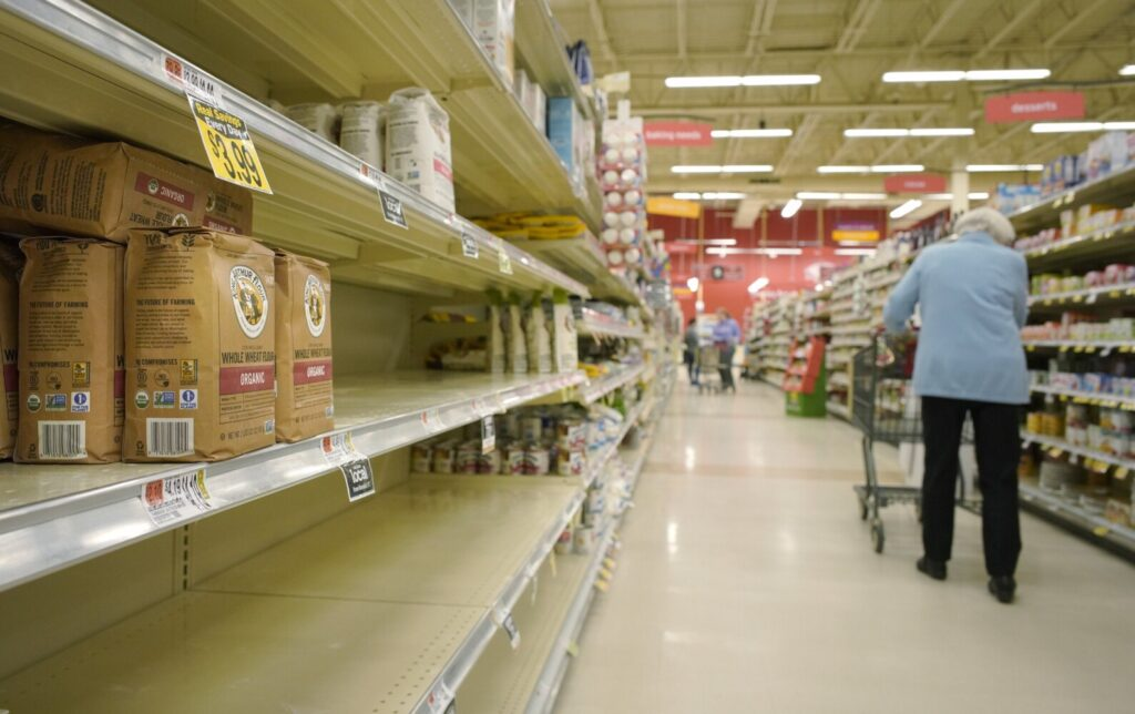 Shelves in the flour section of Hannaford supermarket in Scarborough were mostly bare in late March. While supermarkets and grocery stores still have plenty of food, certain basic items are likely to remain in short supply for months.