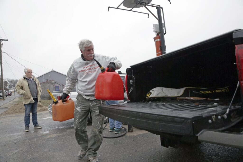 Dean Kamp, a house painter, loads up on gasoline on Monday after Peaks Island's lone gas station and laundromat -- owned and operated by Lionel Plante Associates -- announced Sunday that operations would temporarily close after a worker tested positive for COVID-19.