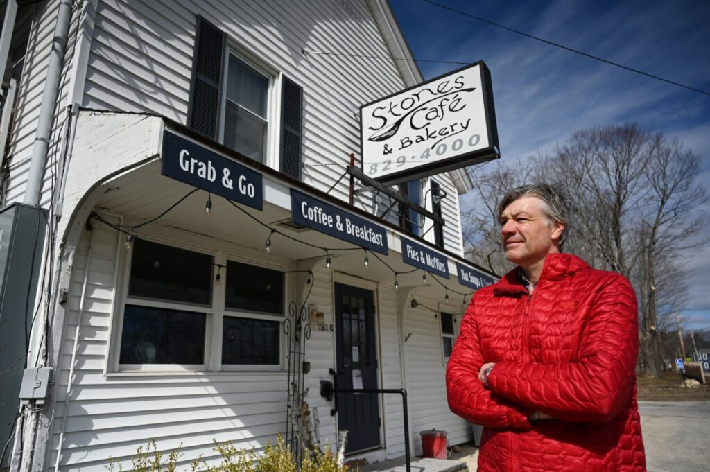 Roger Beaudoin stands outside his Stones Cafe & Bakery in North Yarmouth, a small business that he had to close, laying off his workers, due to the coronavirus pandemic, on Tuesday.