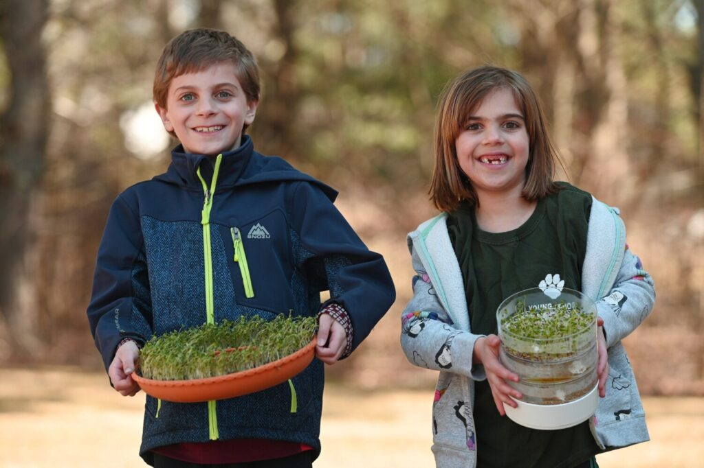Spencer 9, and Lauren Pahigian 6, show off microgreens and sprouts that they have grown at their home in Saco.
