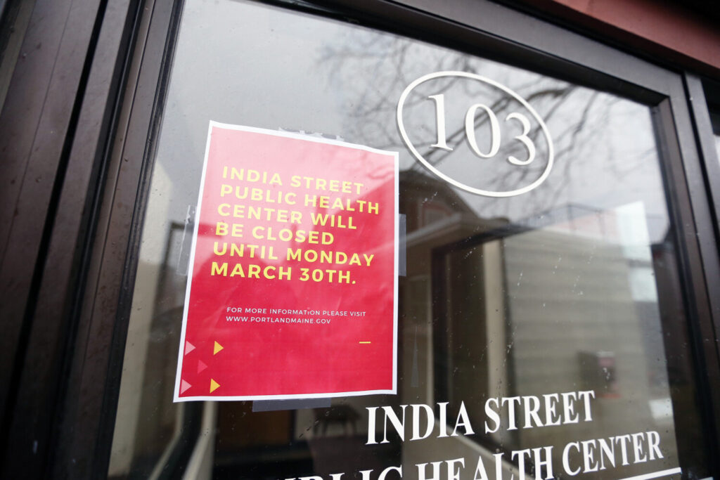 A sign at Portland's India Street Public Health Center informs patients that it is closed until March 30 after an employee has presumptively tested positive for COVID-19.