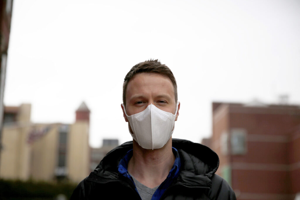 "Andrew Bruns of Portland wears a protective mask on Friday. Bruns said he was wearing the mask because he traveled recently in Thailand but had no symptoms and was not sick. ""I'm wearing this as a courtesy to others,"" he said. Health officials say masks are not the most effective means of protecting against the coronavirus and should instead be worn by those who are already infected to prevent spreading the disease to others. Frequent and proper hand washing as well as social distancing practices are the best ways to stay healthy."
