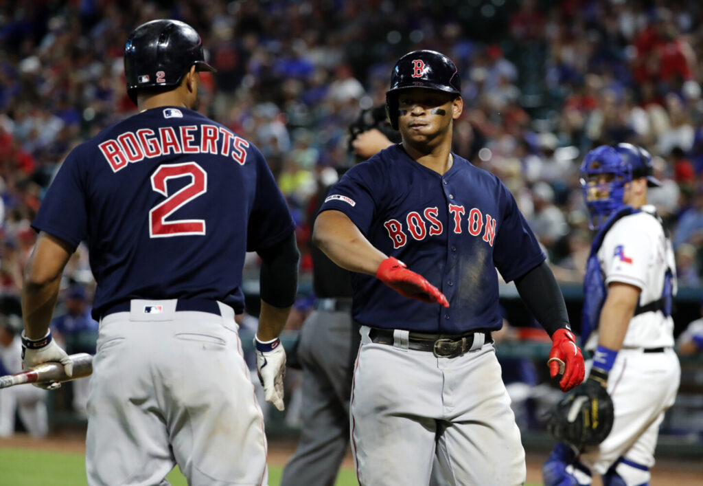 "Red Sox third baseman Rafael Devers, right, has developed a relationship with shortstop Xander Bogaerts. ""Xander eased my transition,"" Devers said of his arrival in the major leagues."