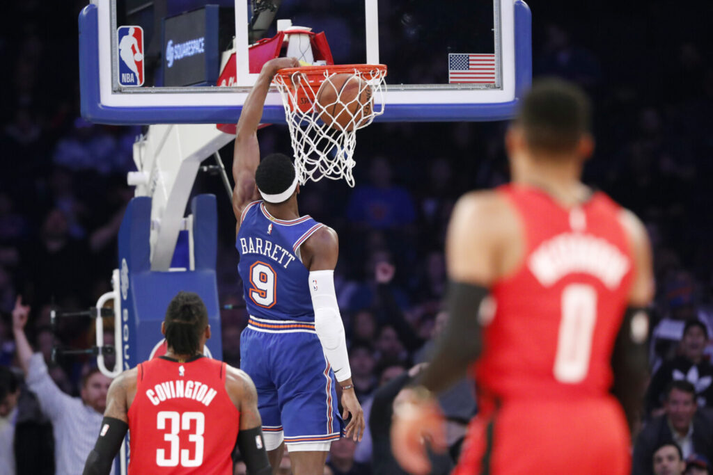 Houston's Robert Covington and Russell Westbrook watch as New York Knicks guard RJ Barrett during the Knicks' 125-123 win Monday in New York.