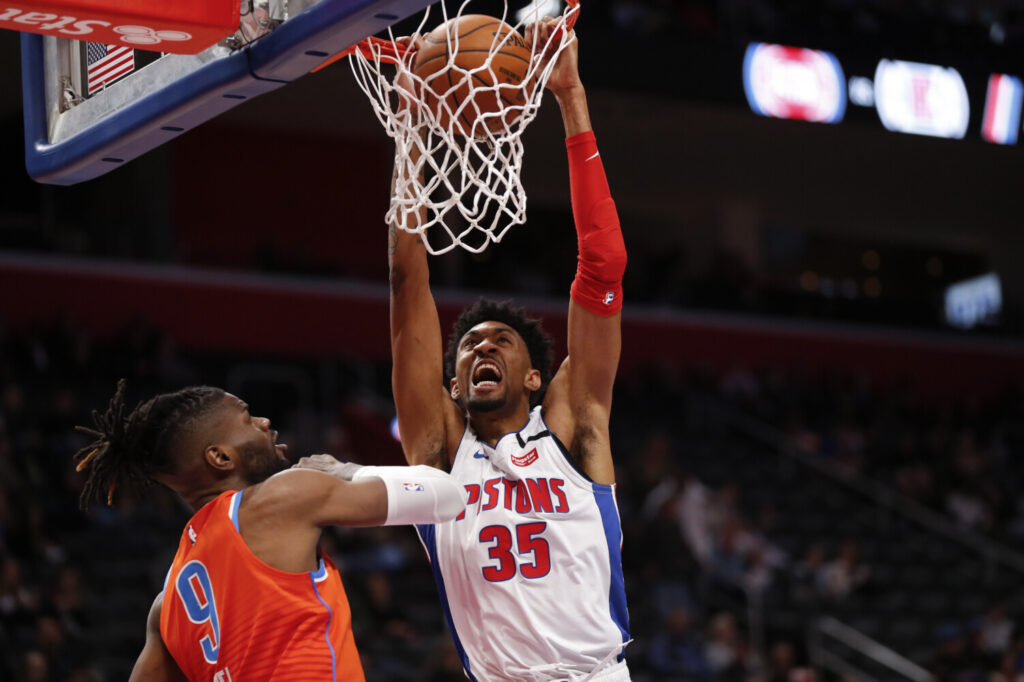 Detroit Pistons forward Christian Wood, right, is tested positive for the coronavirus, according to a source. Wood would be the third NBA player, after Rudy Gobert and Donovan MItchell, to test positive for the virus.