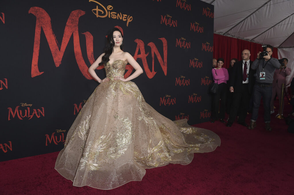 """Yifei Liu arrives at the Los Angeles premiere of """"Mulan"""" at the Dolby Theatre on Monday, Mar. 09, 2020."""