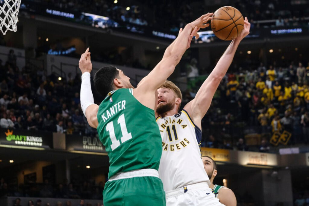 Indiana's Domantas Sabonis, right, tries to shoot around Boston center Enes Kanter during Tuesday's game in Indianapolis.
