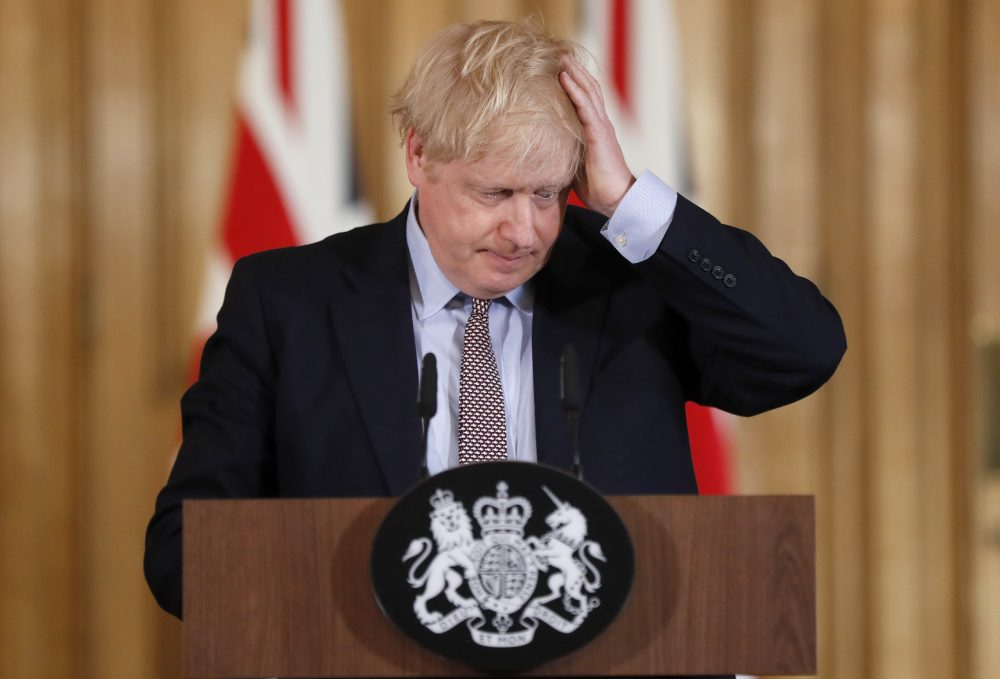 Britain's Prime Minister Boris Johnson reacts during a press conference at Downing Street on the government's coronavirus action plan in London, Tuesday, March 3, 2020.
