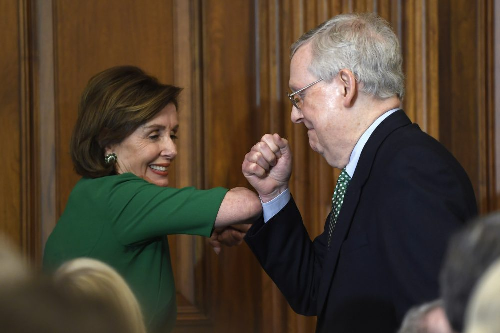 House Speaker Nancy Pelosi of Calif., left, and Senate Majority Leader Mitch McConnell of Ky., right, bump elbows Thursday as they attend a lunch with Irish Prime Minister Leo Varadkar on Capitol Hill in Washington.