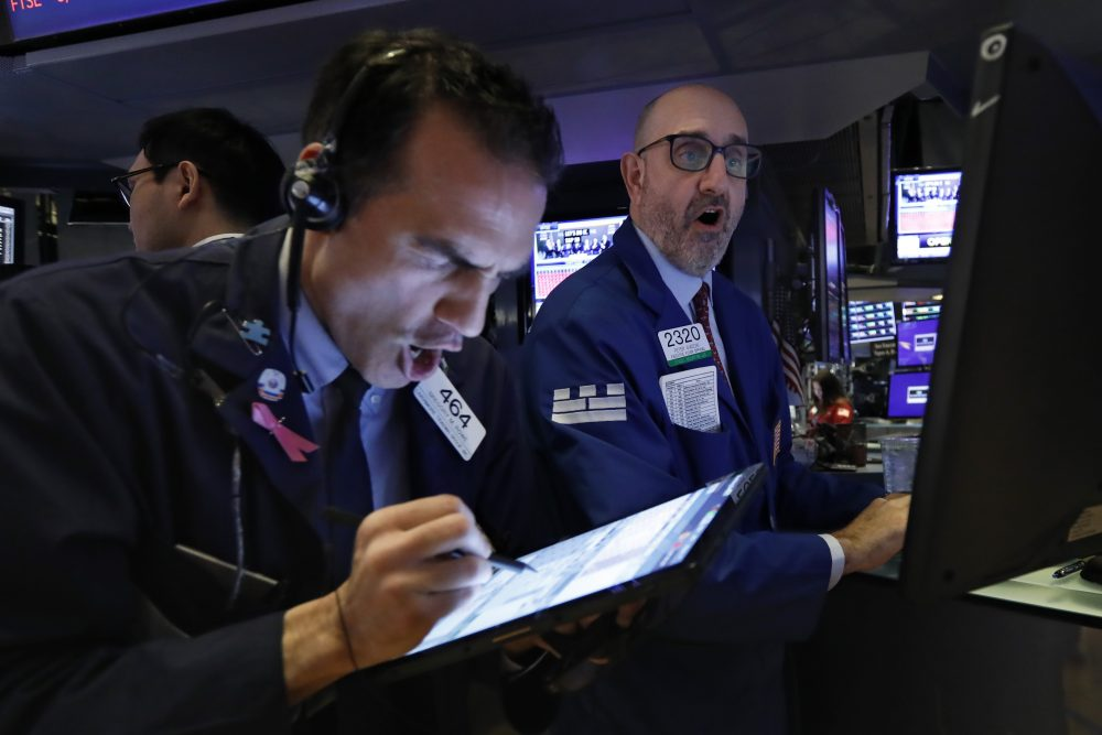 Trader Gregory Rowe, left, and specialist Peter Giacchi work on the floor of the New York Stock Exchange on Thursday morning.