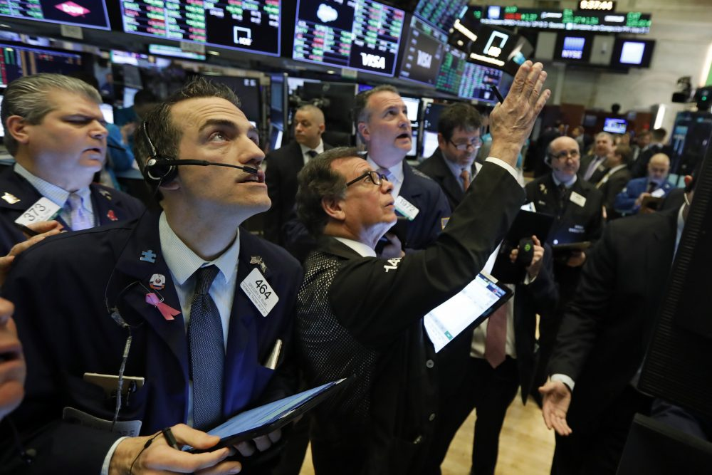 Traders gather at a post on the floor of the New York Stock Exchange on Wednesday, where stocks surged in early trading, led by health care stocks, after Joe Biden scored a number of Super Tuesday wins.