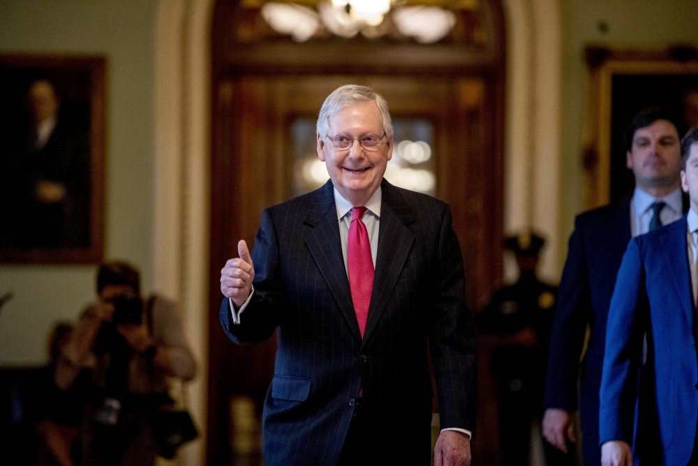 Senate Majority Leader Mitch McConnell of Kentucky gives a thumbs up as he leaves the Senate chamber on Capitol Hill in Washington, on Wednesday, where a deal was  reached on a coronavirus bill.