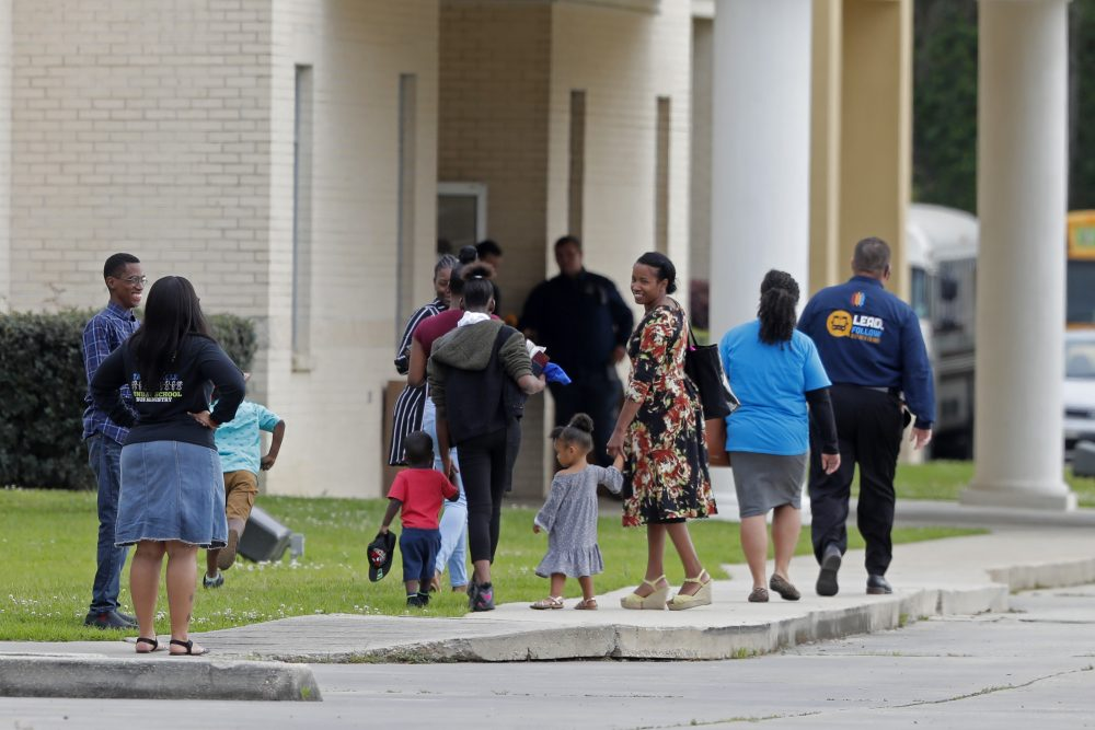 Congregants arrive at the Life Tabernacle Church in Central, La., on Sunday.