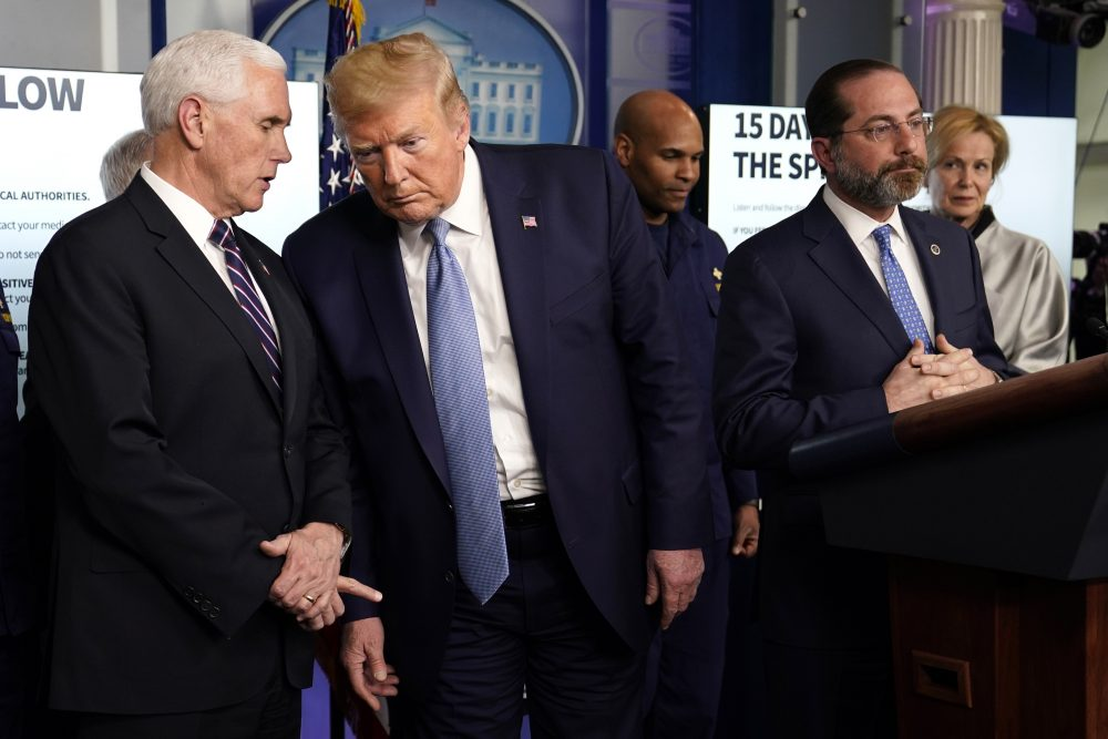 President Donald Trump listens to Vice President Mike Pence, left, as Health and Human Services Secretary Alex Azar speaks during a press briefing with the coronavirus task force, in the Brady press briefing room at the White House, Monday, March 16.