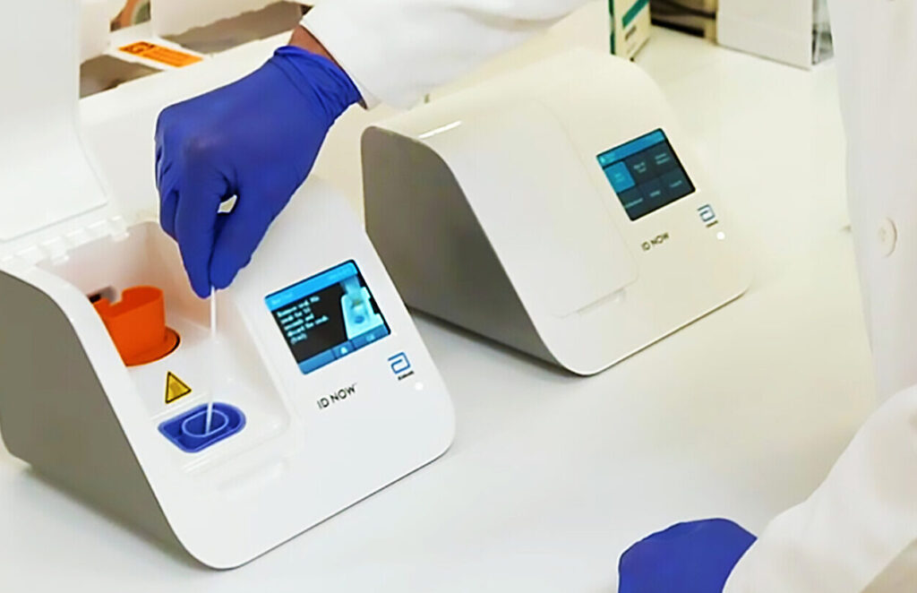 Abbott Laboratories helped design and is mass producing a new COVID-19 test that will give results within minutes. The photo shows a test being run. (Photo courtesy of Abbott Laboratories)